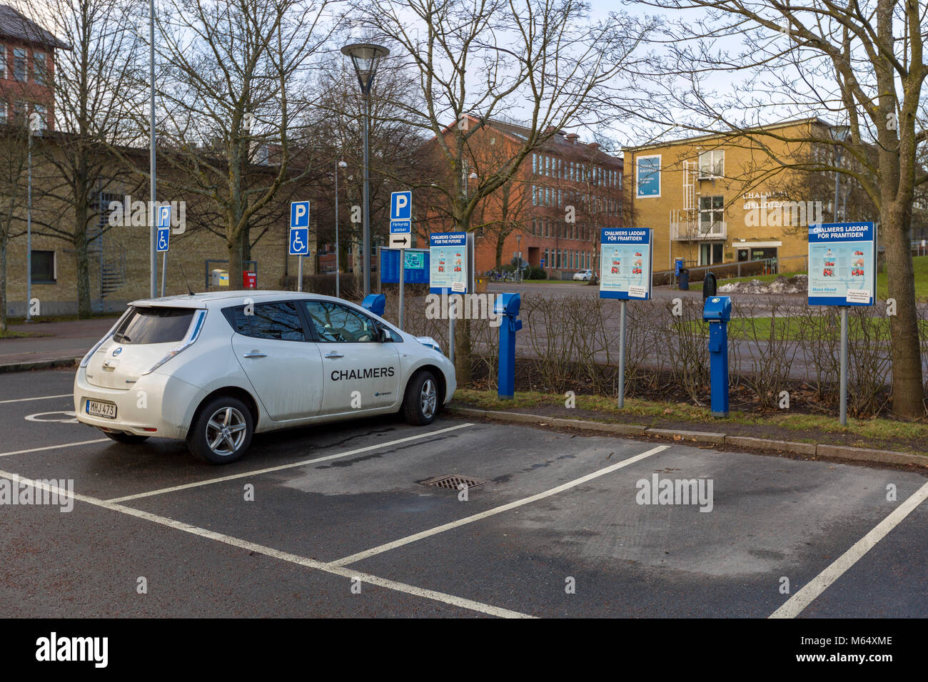 GOTHENBURG, SWEDEN - JANUARY 27 2018: Electric BMW car plugged into charging station, Chalmers University of Technology, - Stock Image