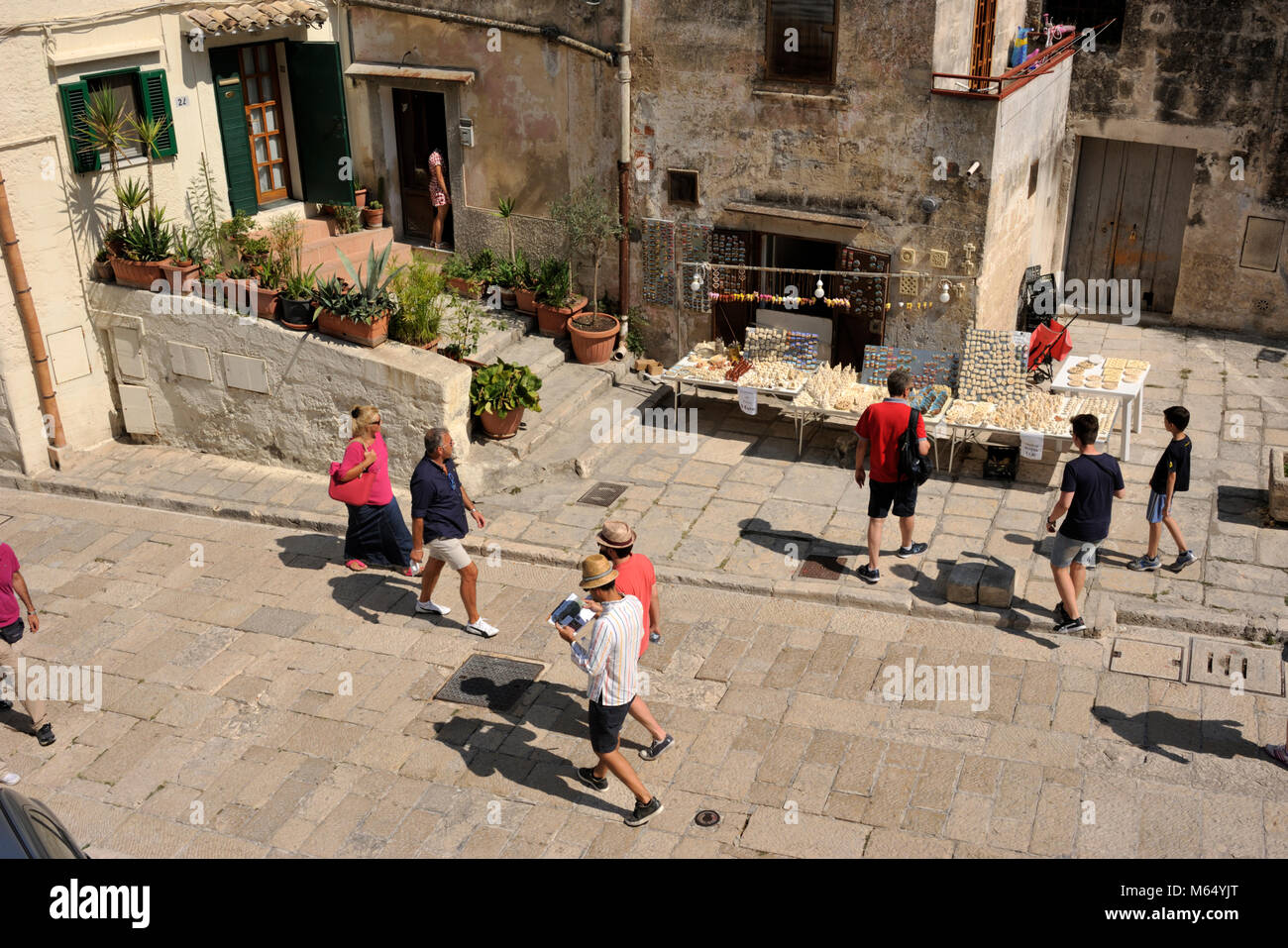 italy, basilicata, matera, sassi, sasso caveoso, cobbled street, tourists and souvenirs shop - Stock Image