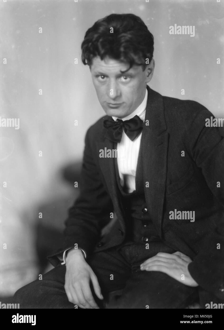 Black and white portrait photograph of German-American, Expressionist painter Josef Scharl, shown in three-quarter - Stock Image