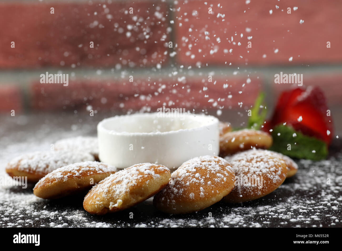 Mini pancakes with strawberry & syrup - Stock Image