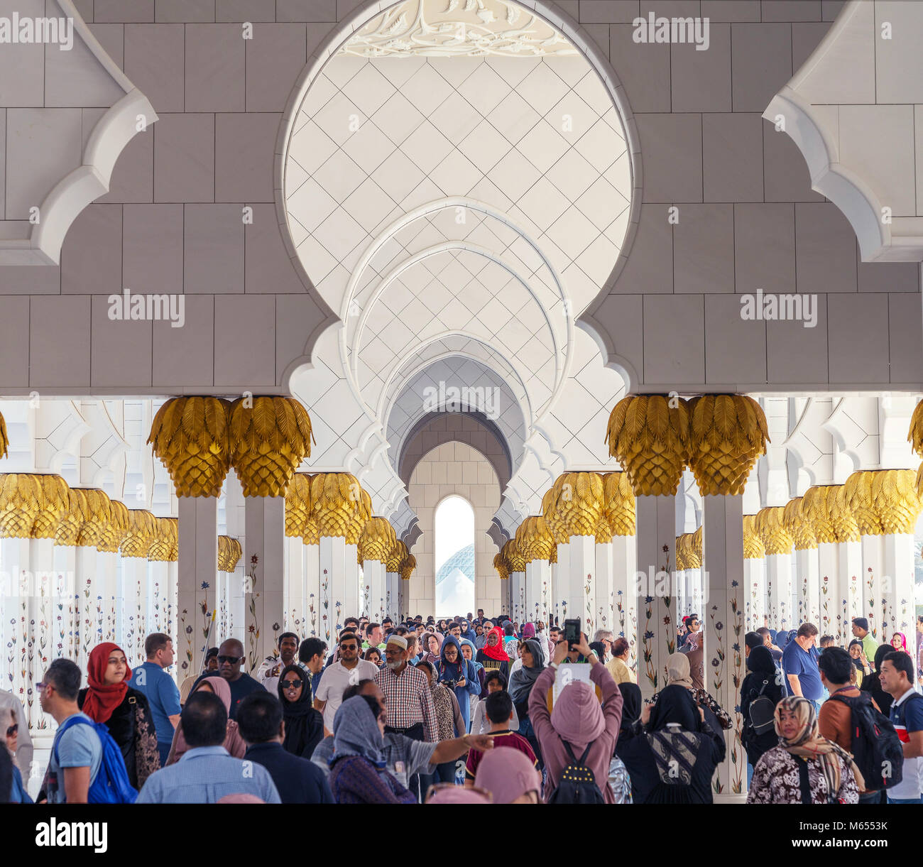 28th December 2017 - Abu Dhabi, UAE. Tourists visiting gorgeous Sheikh Zayed mosque during winter holidays. Stock Photo