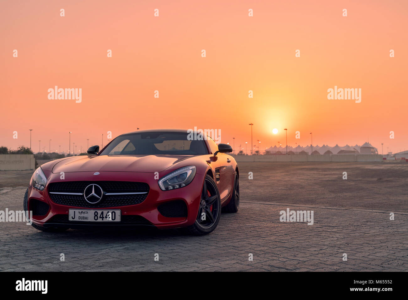 28th December 2017 - Abu Dhabi, UAE. Red Mercedes SLS GTs in front of a beautiful sunset. Stock Photo