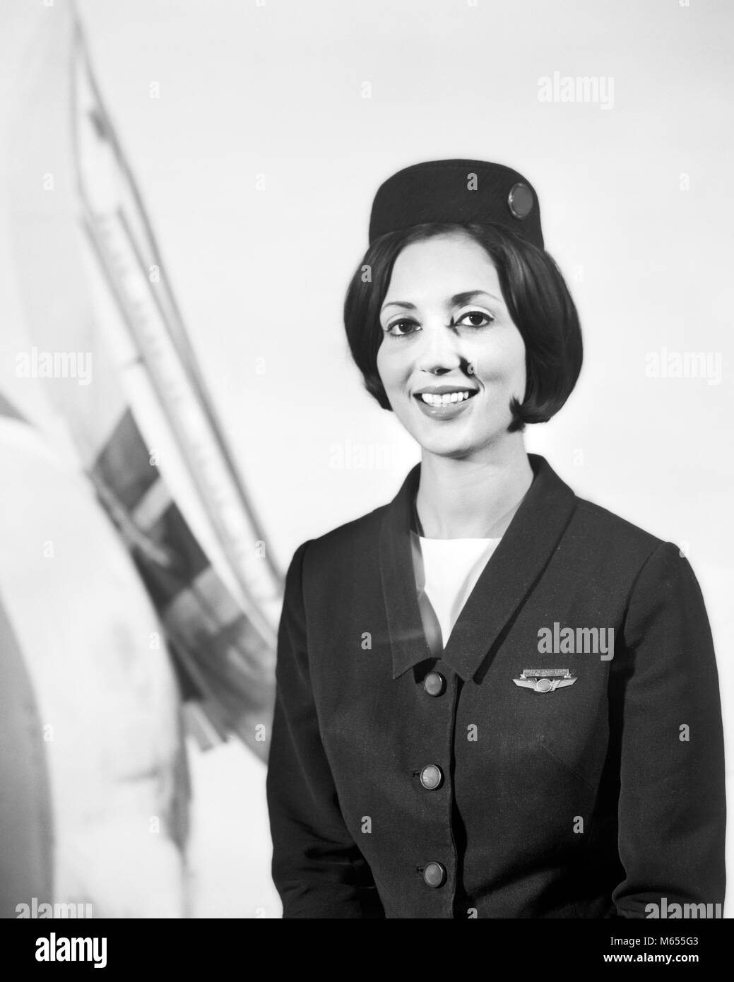 1960s SMILING FEMALE STEWARDESS FLIGHT ATTENDANT LOOKING AT CAMERA - a7414 HAR001 HARS FEMALES JOBS FLIGHT ONE PERSON - Stock Image
