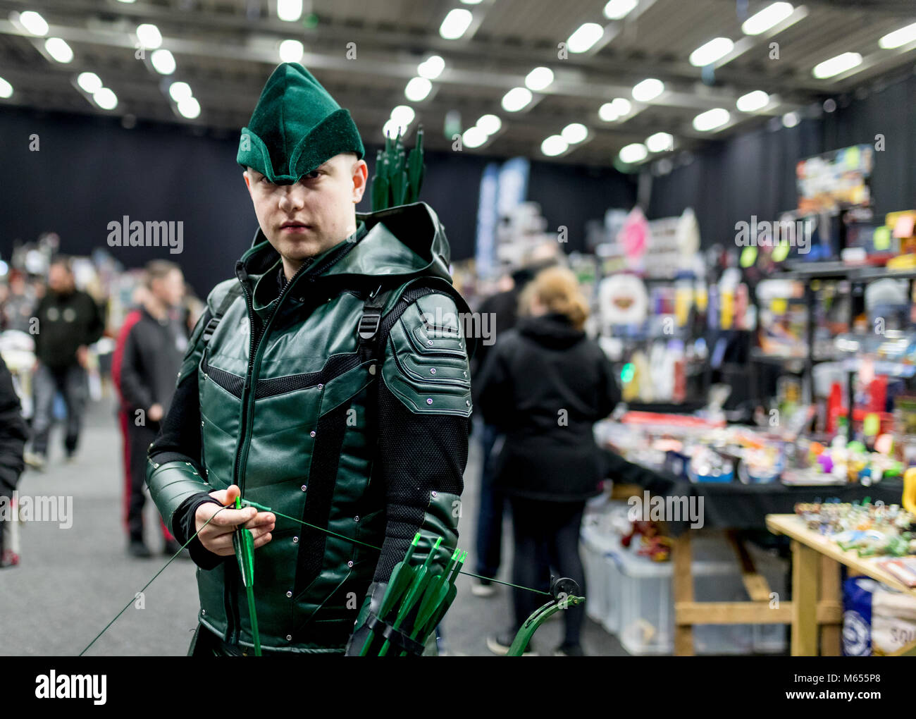 Doncaster Comic Con 11th Feruary 2018 at The Doncaster Dome. Man dressed as Arrow from DCs Green Arrow TV series - Stock Image