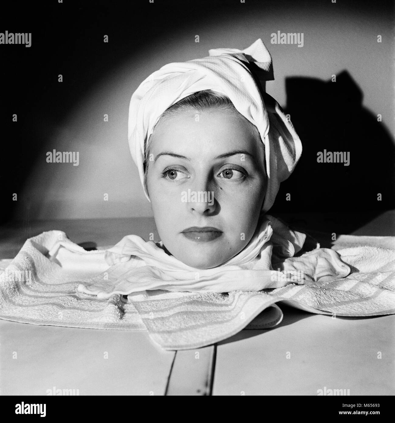 1950s PORTRAIT HEAD SHOT OF WOMAN RELAXING IN SPA SAUNA STEAM CABINET TOWEL  WRAPPED AROUND HEAD