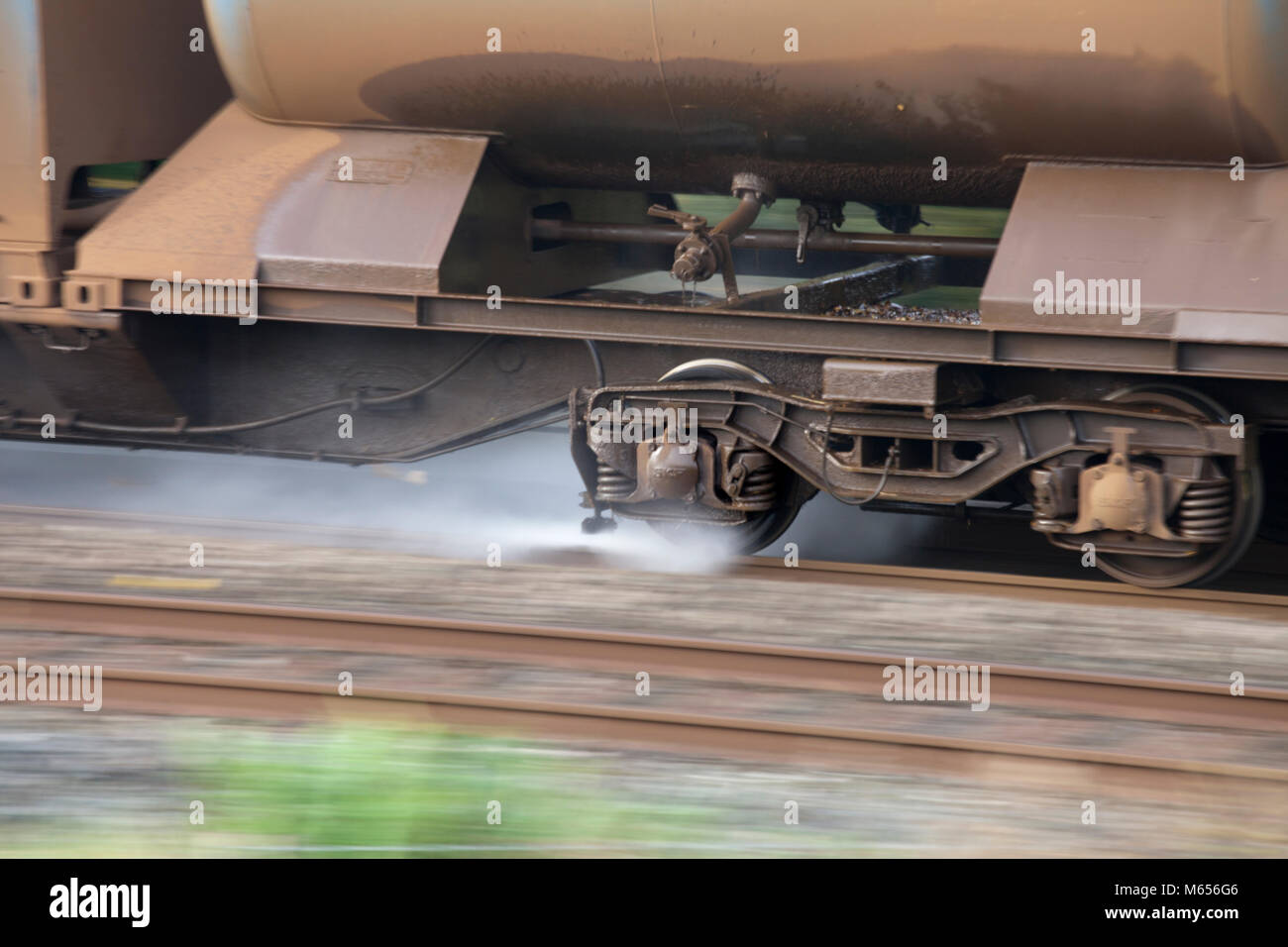 WATER JET SPRAYING FROM A NETWORK RAIL RAILHEAD TREATMENT TRAIN (WATER CANNON)  WASHING LEAF MULCH FROM THE SLIPPERY - Stock Image
