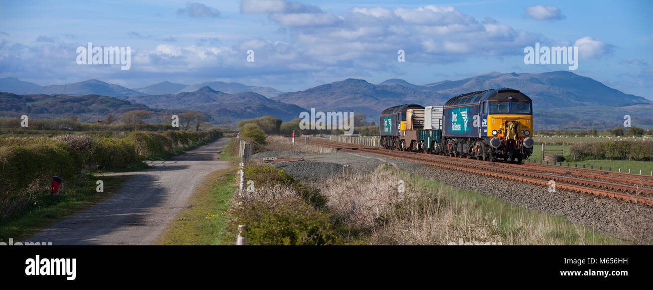2 Direct rail Services class 57 locomotives pass Millom marsh, Cumbria with the nuclear flasks from   Heysham - Stock Image