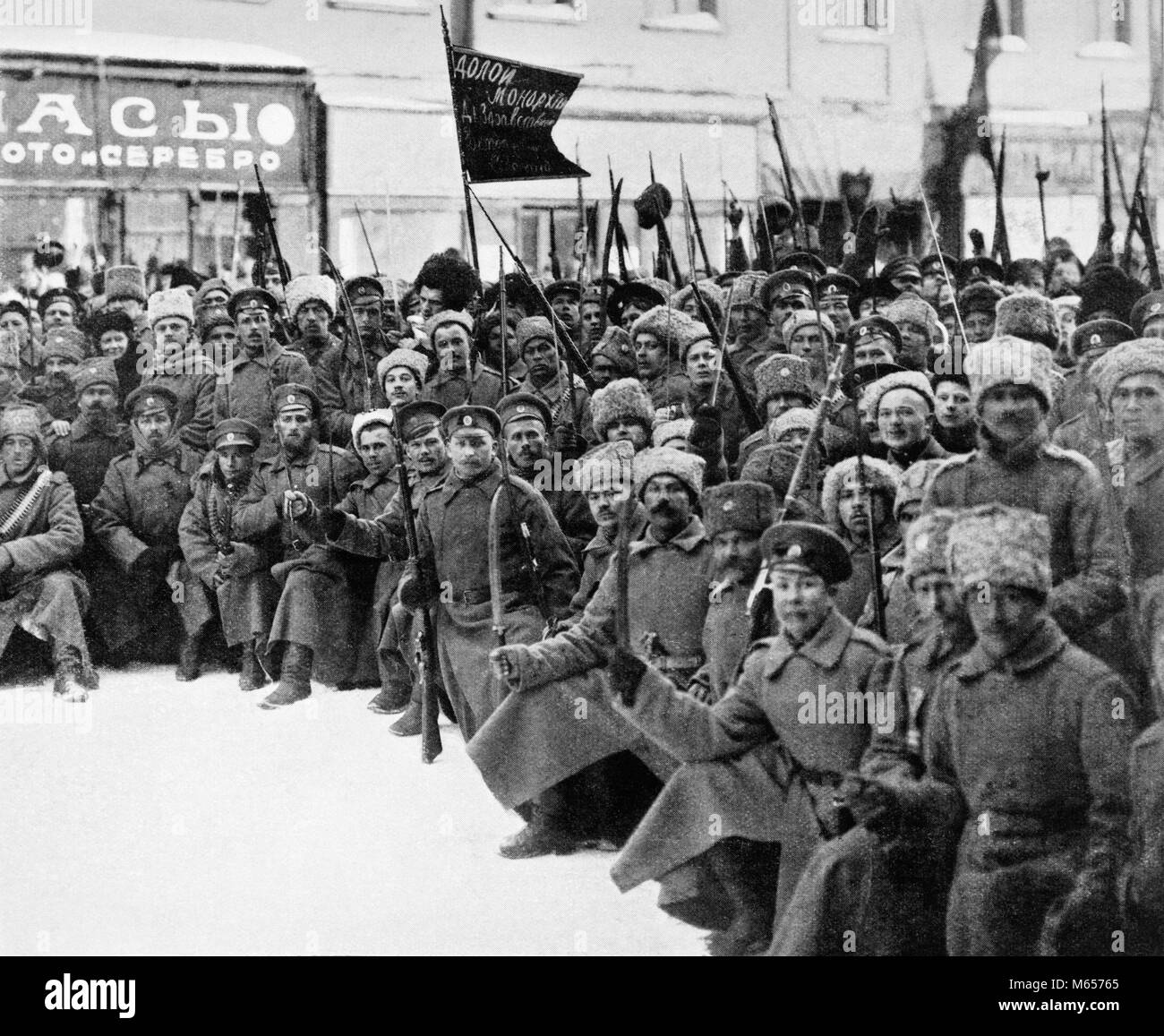 1900s 1917 SIBERIAN RIFLES AND COSSACKS TROOPS WITH SIGNS DOWN WITH MONARCHY ON WAY TO DUMA IN PETROGRAD ST. PETERSBURG - Stock Image
