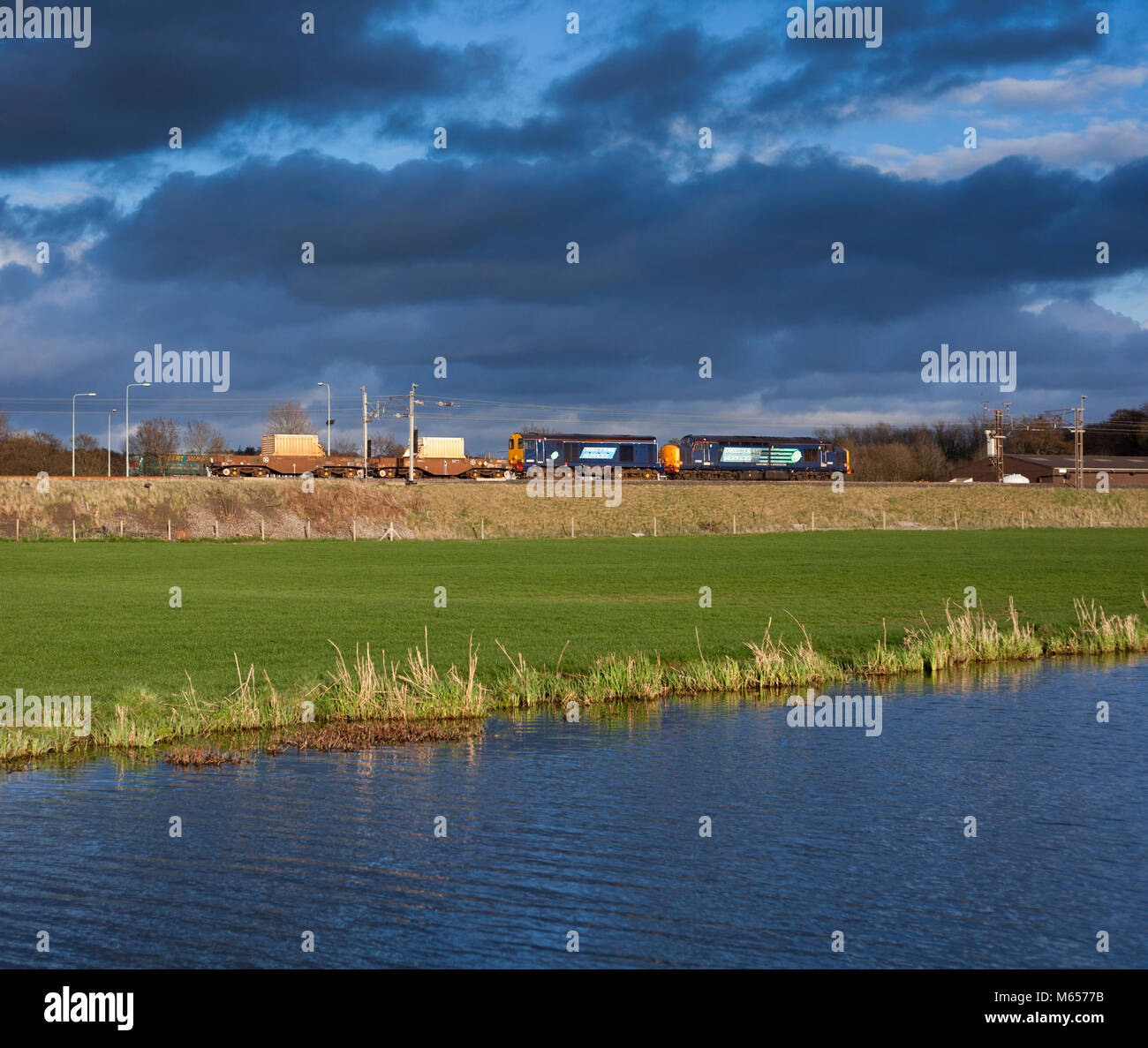 Direct rail services class 37 + 20 locomotives at Catterall North of Preston,  with a  nuclear Flask train - Stock Image