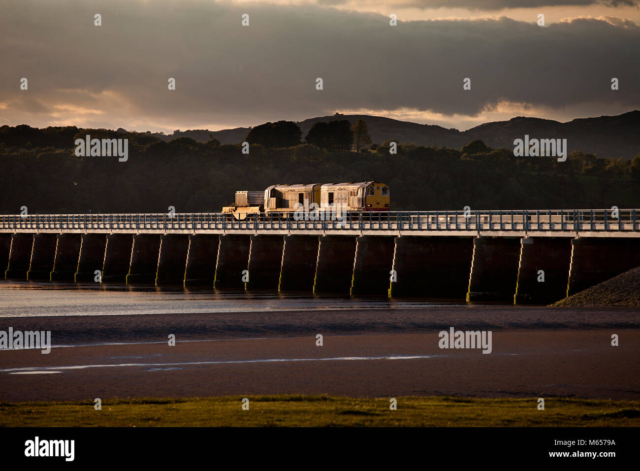 Direct rail services class 20 locomotives 20308 + 20302 glinting as they crossing  Arnside  viaduct  with a nuclear - Stock Image