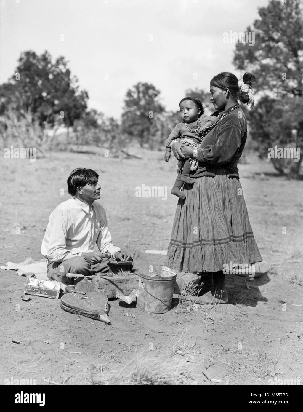 1930 NATIVE AMERICAN NAVAJO INDIAN MAN SILVERSMITH WITH WIFE WOMAN AND BABY CHILD - i1134 HAR001 HARS MOTHERS OLD - Stock Image