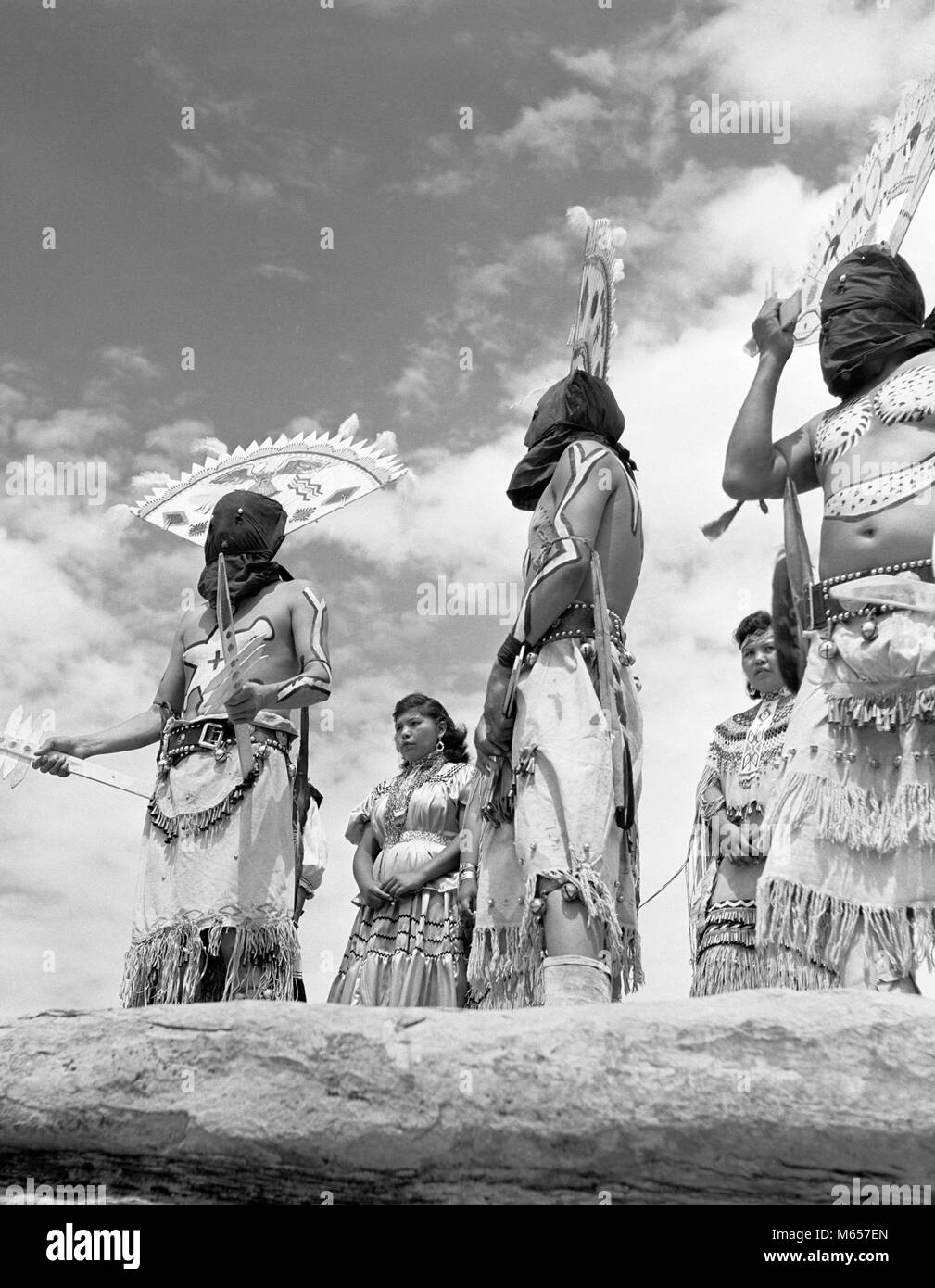 1950s GROUP OF NATIVE AMERICAN APACHE INDIANS PERFORMING APACHE DEVIL DANCE SOUTHWEST USA - i1324 HAR001 HARS DREAMS - Stock Image