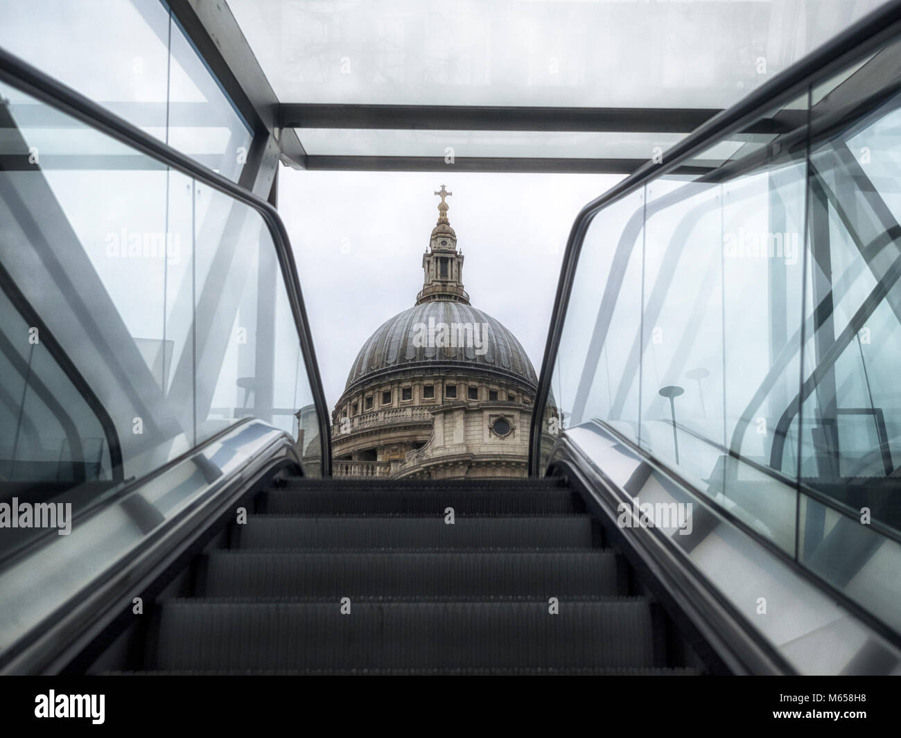 LONDON, UK:  View of the dome of St Paul's Cathedral coming up the escalator of One New Change Centre - Stock Image