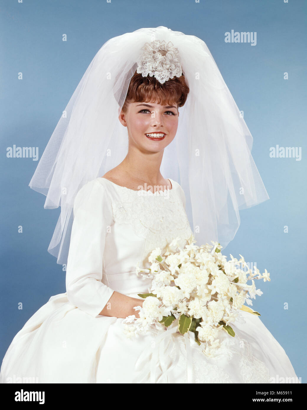 1da9d5f0e 1960s PORTRAIT SMILING WOMAN BRIDE IN SIMPLE WHITE WEDDING GOWN HOLDING  WHITE FLOWER BOUQUET LOOKING AT CAMERA - kb5240 HAR001 HARS COPY SPACE  HALF-LENGTH ...