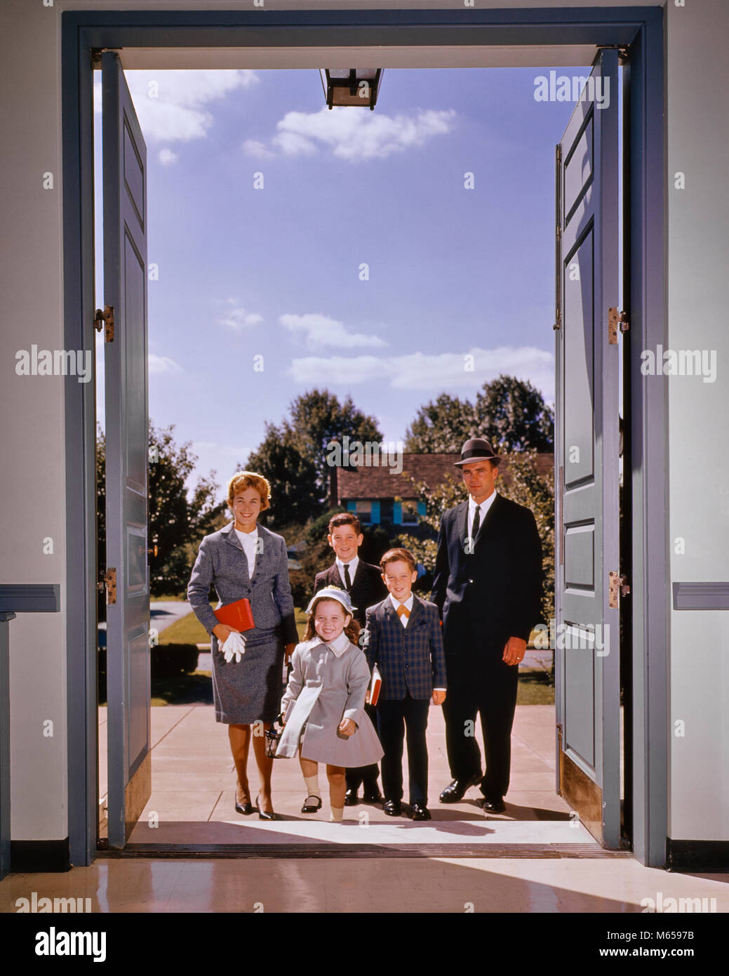 1960s Family Of Five Walking In The Front Door Of Church Looking At