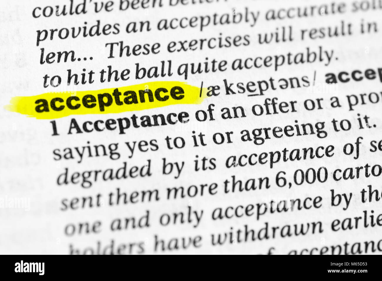 Highlighted English word 'acceptance' and its definition in the dictionary. - Stock Image