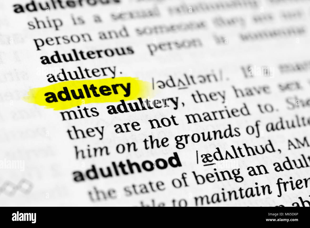 Highlighted English word 'adultery' and its definition in the dictionary. - Stock Image