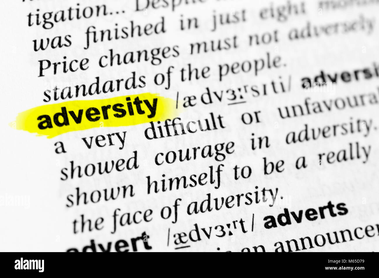 Highlighted English word 'adversity' and its definition in the dictionary. - Stock Image
