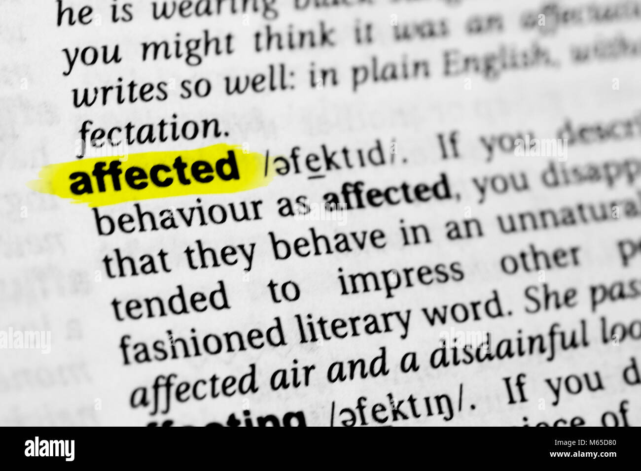 Highlighted English word 'affected' and its definition in the dictionary. - Stock Image