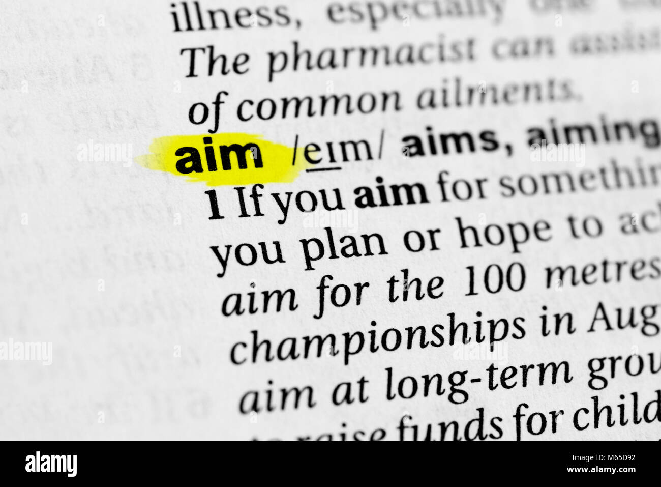 Highlighted English word 'aim' and its definition in the dictionary. - Stock Image
