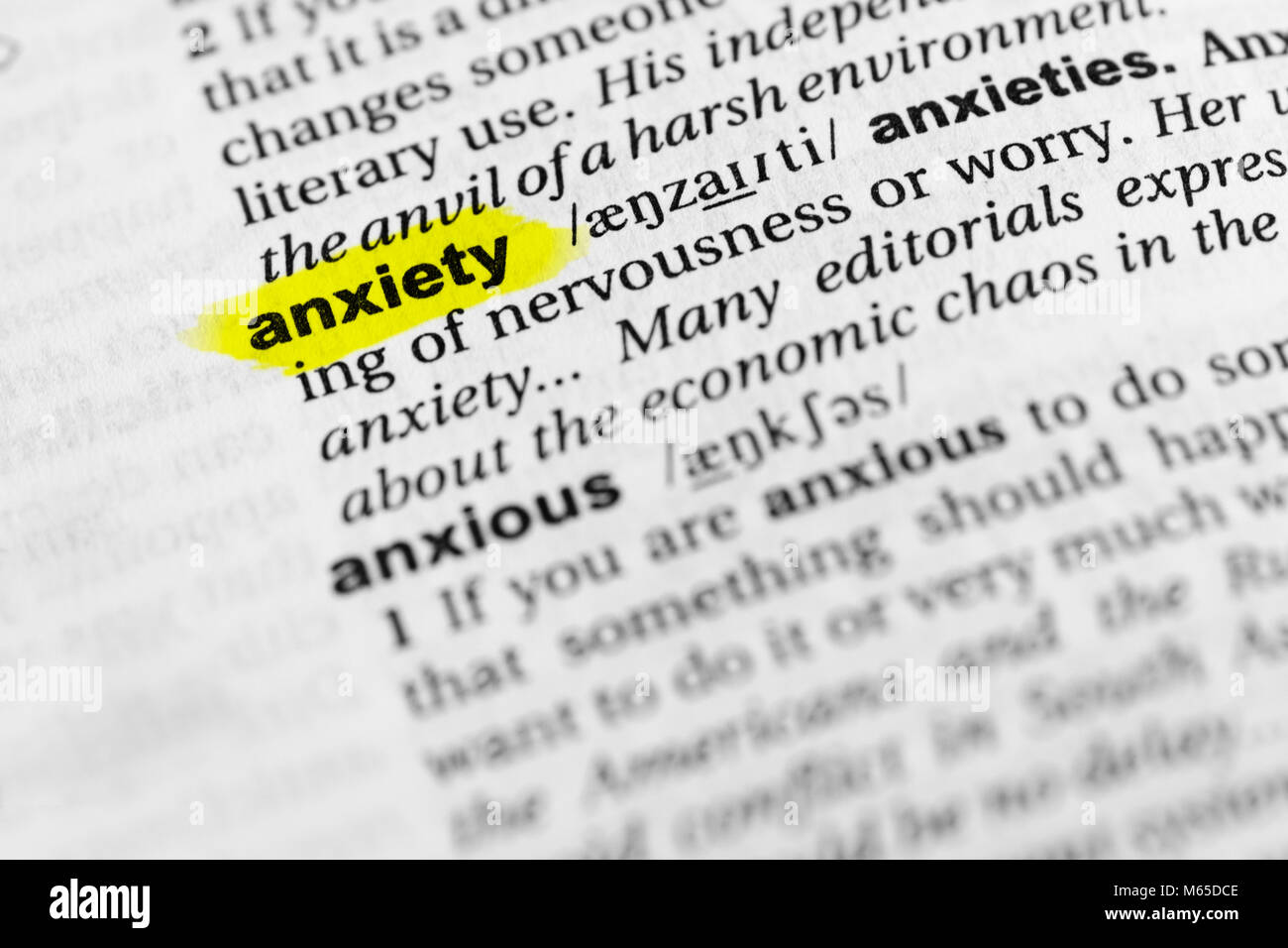 Highlighted English word 'anxiety' and its definition in the dictionary. - Stock Image