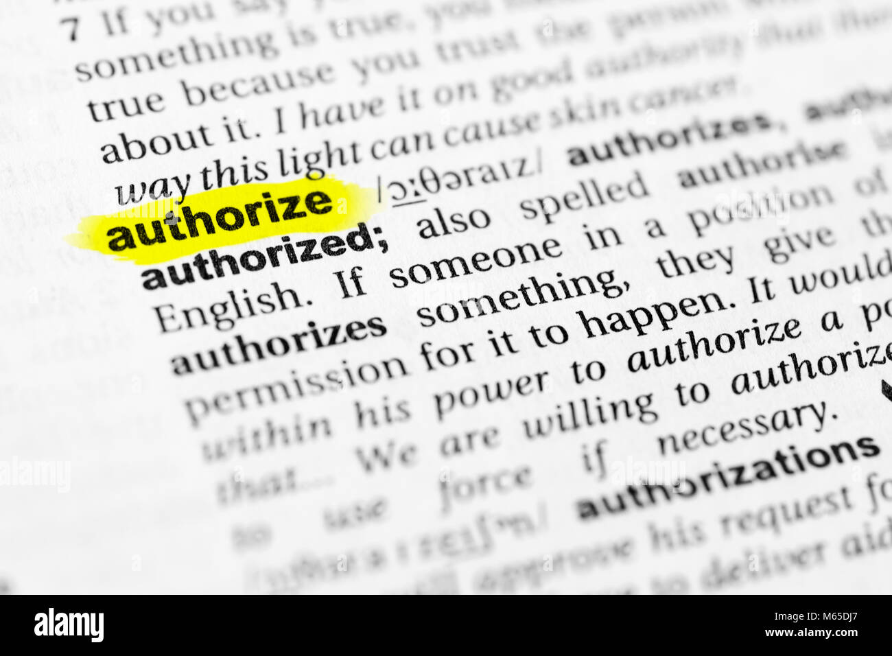 Highlighted English word 'authorize' and its definition in the dictionary. - Stock Image