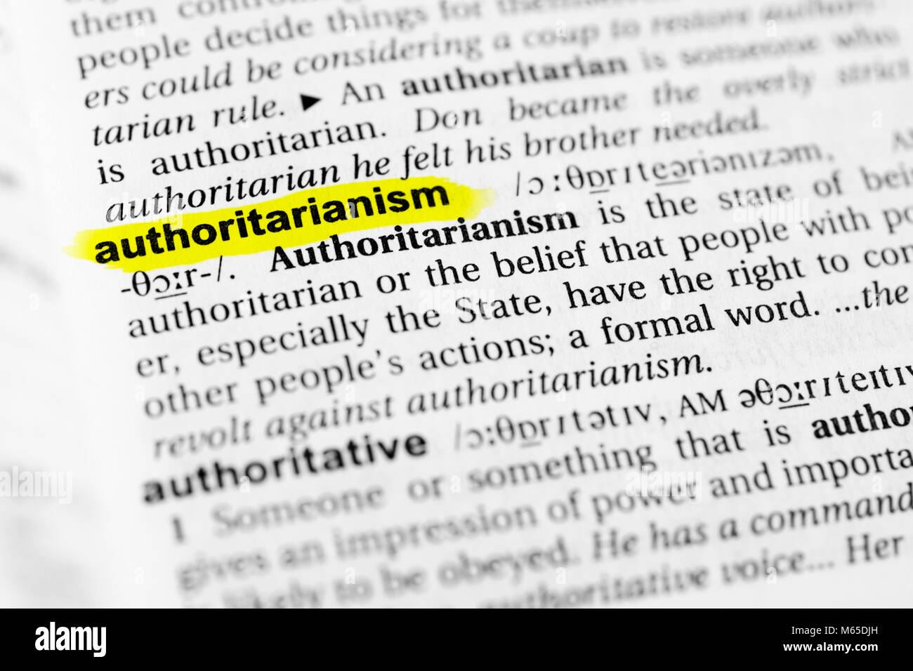 Highlighted English word 'authoritarianism' and its definition in the dictionary. - Stock Image
