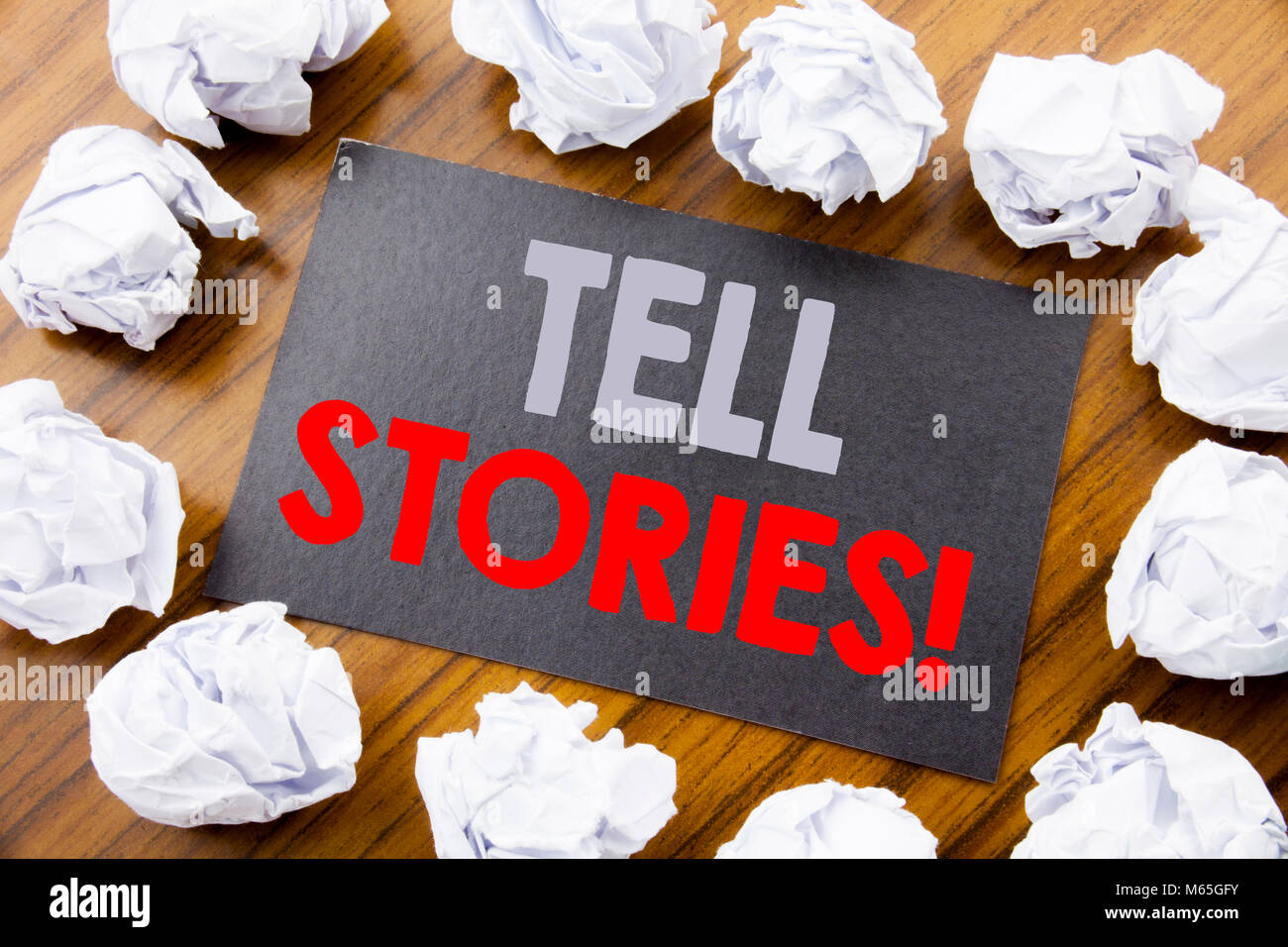 Hand writing text caption showing Tell Stories. Business concept for Storytelling Telling Story written on sticky - Stock Image