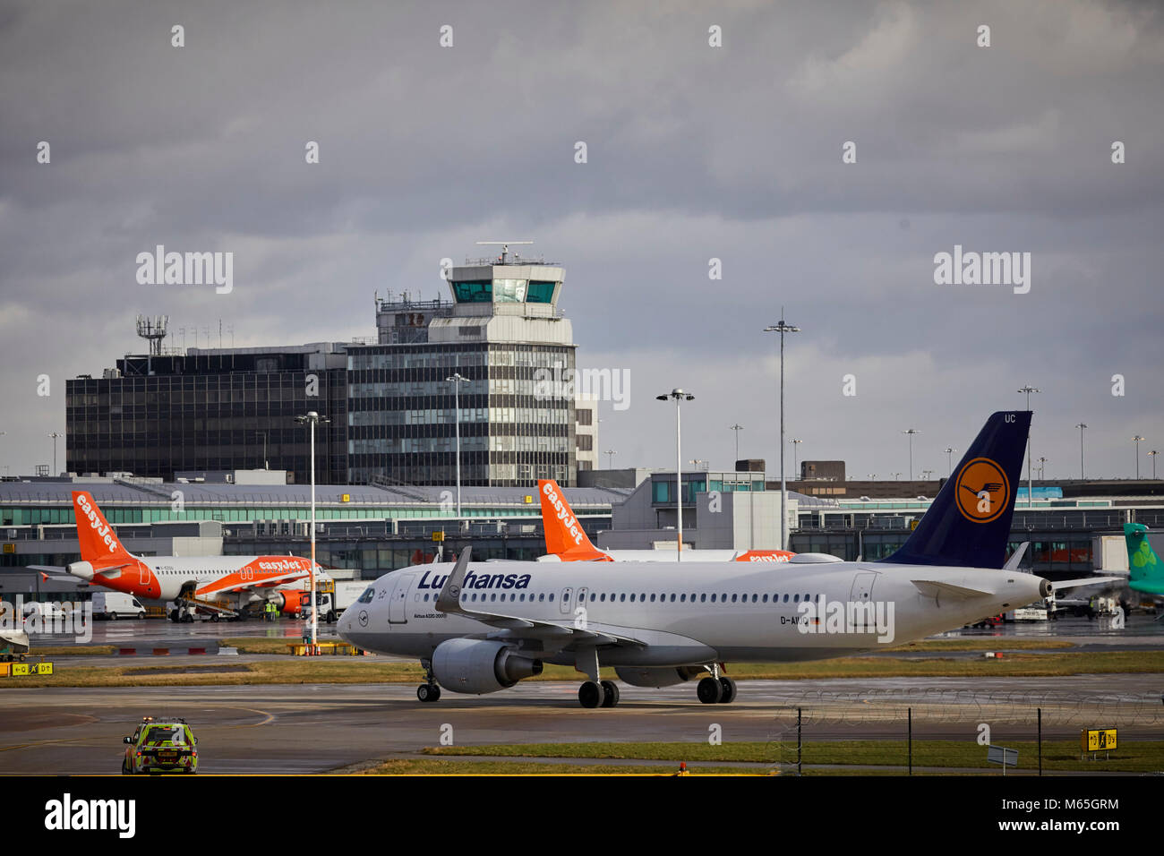 Manchester Airport D-AIUC Lufthansa Airbus A320-214 taxing to the terminal after arriving form Germany - Stock Image
