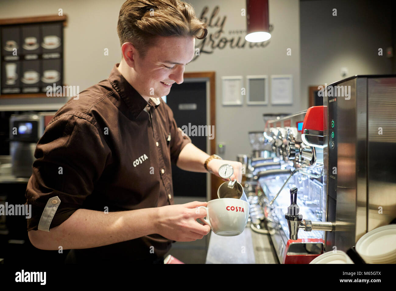 Costa coffee shop worker in store - Stock Image