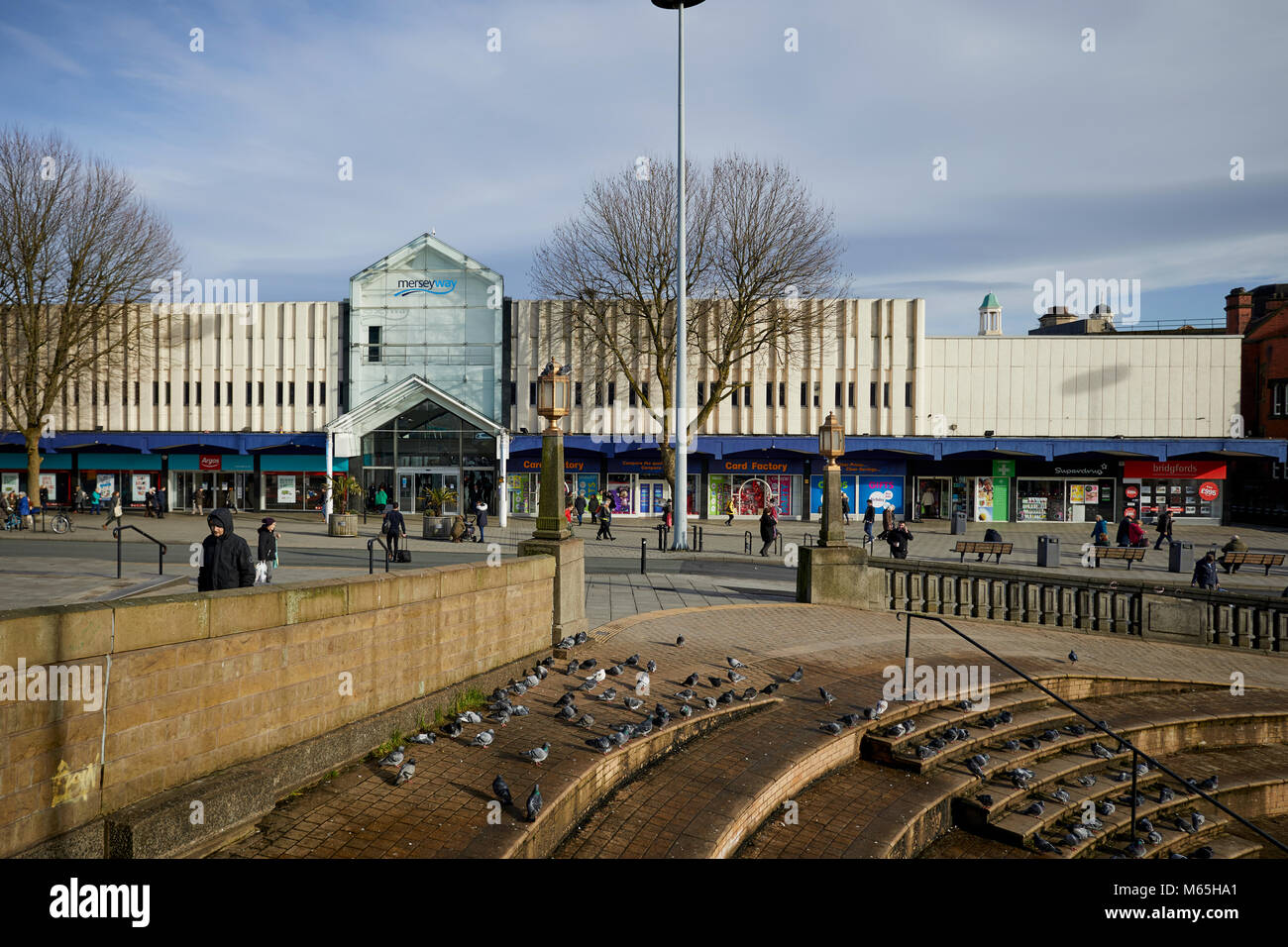 Mersey Square featuring the bears pit and the Merseyway shopping centre in the background, in Stockport - Stock Image