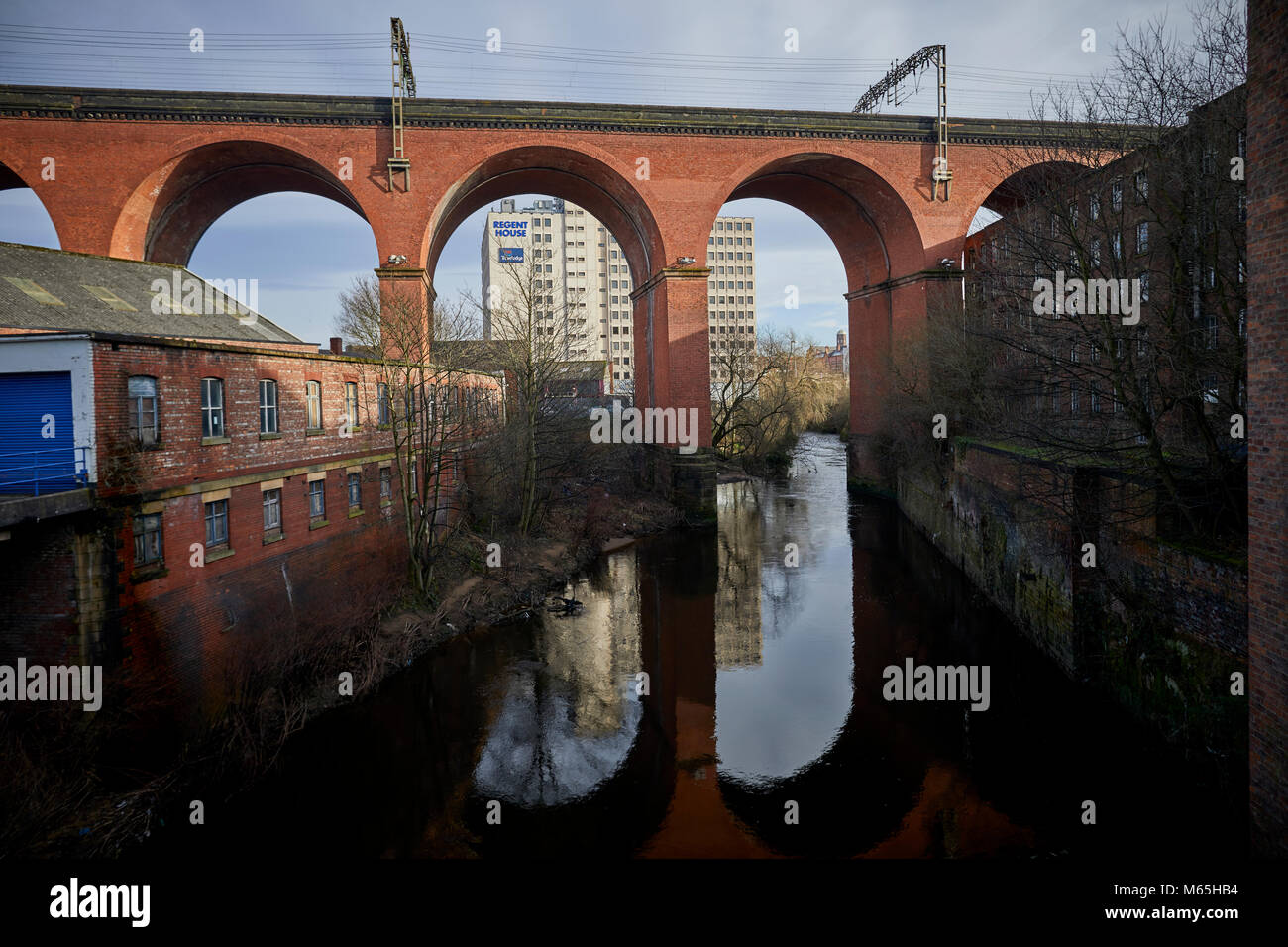 Stockport Viaduct reflecting into the River Mersey, in Stockport - Stock Image