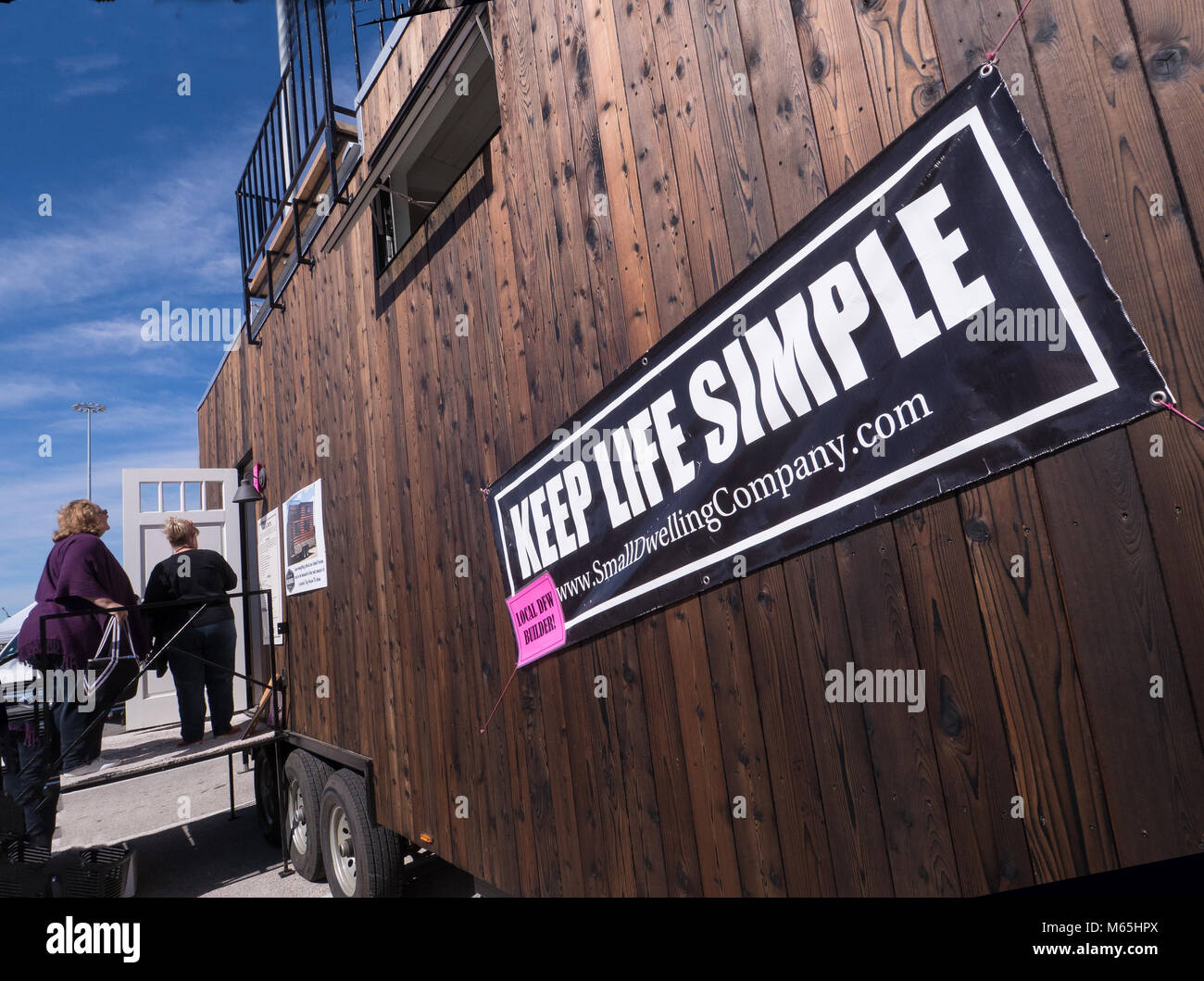 Looking for a simpler life, living less than 500 square feet. Attendees at 2017 National Tiny Homes and Simple Living - Stock Image