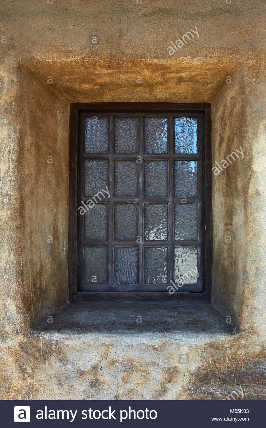 19th Century, Vintage, Old Mission Style, Mexican, South Western, North American  Windows And Doors Framed By Stucco And Brick Wall. Circa 1800
