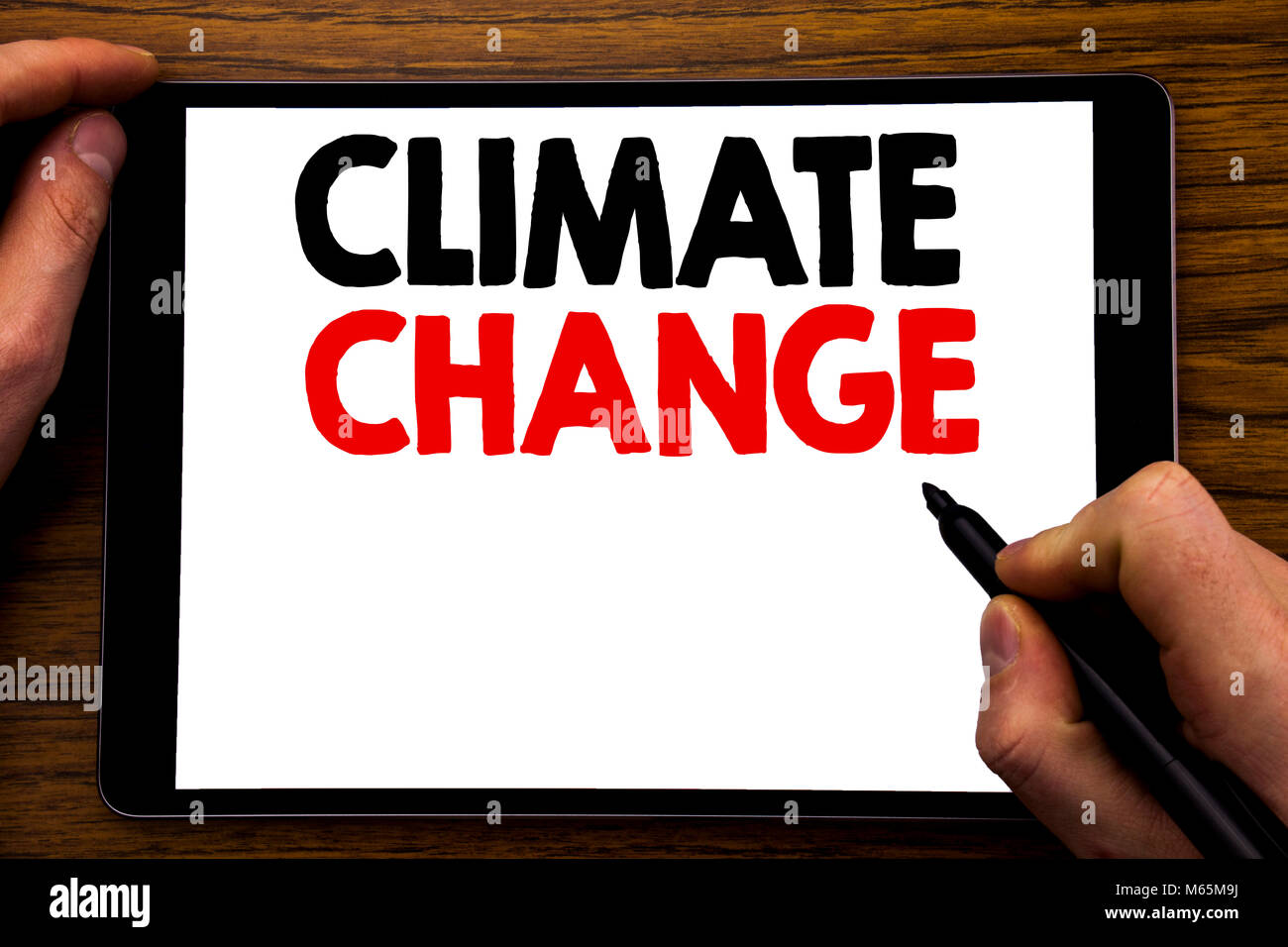 Handwriting Announcement text showing Climate Change. Business concept for Global Planet Warming Written tablet - Stock Image