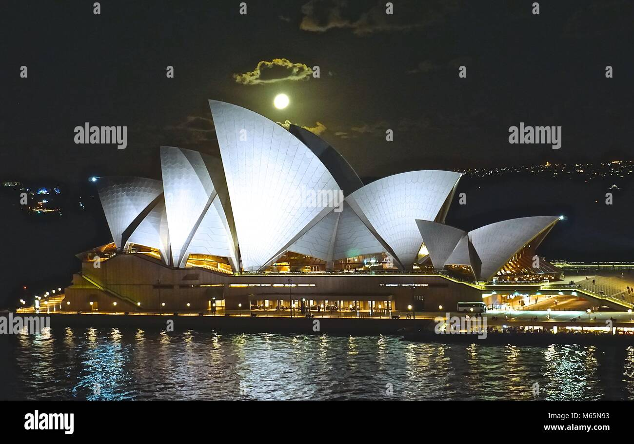 Moon over the opera house in Sydney, Australia - Stock Image