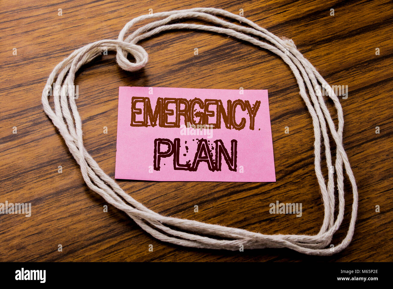 Handwritten text showing Emergency Plan. Business concept for Disaster Protection written on sticky note paper on - Stock Image