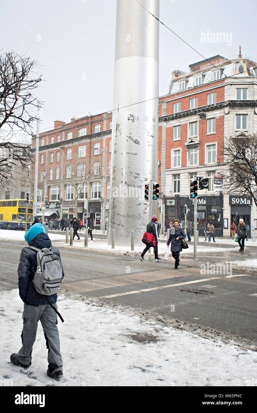 Dublin/Ireland - 02/28/2018 People walking in snowy weather in Dublin city centre, Oconnel Street. Beast from the - Stock Image