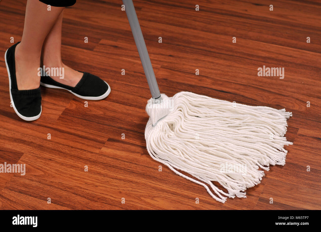 Cleaning service, mop for cleaning wooden floor from dust - Stock Image