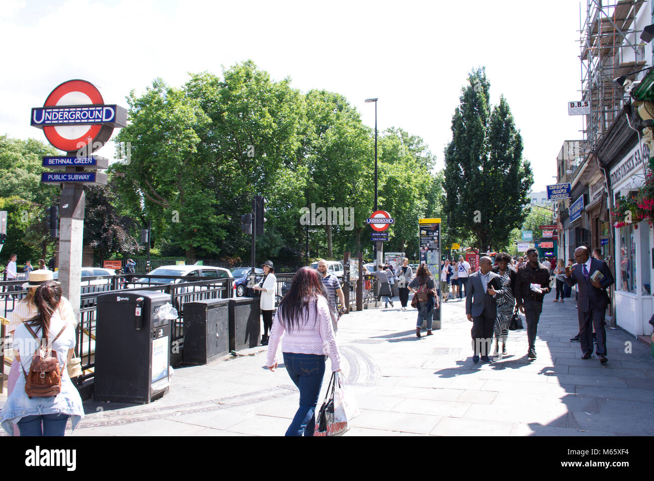 People outside Bethnal Green tube station on  sunny summer day.London,Uk.Street,urban,real,authentic people,editorial.London - Stock Image