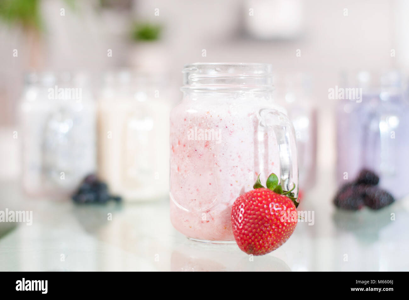 Strawberry milk smoothie in a glass jar, well being and weight loos concept. - Stock Image