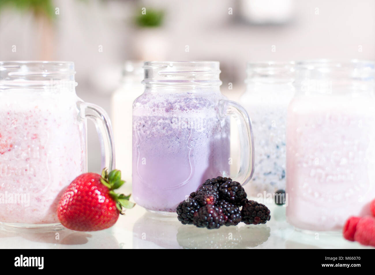 Berry milk smoothie in a glass jar, well being and weight loos concept. - Stock Image