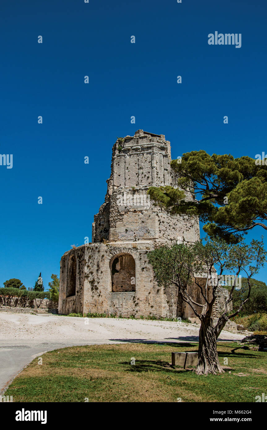 Tour Magne (Magna tower) with blue sky, in the high part of the Gardens of the Fountain at Nimes. Located in the Stock Photo