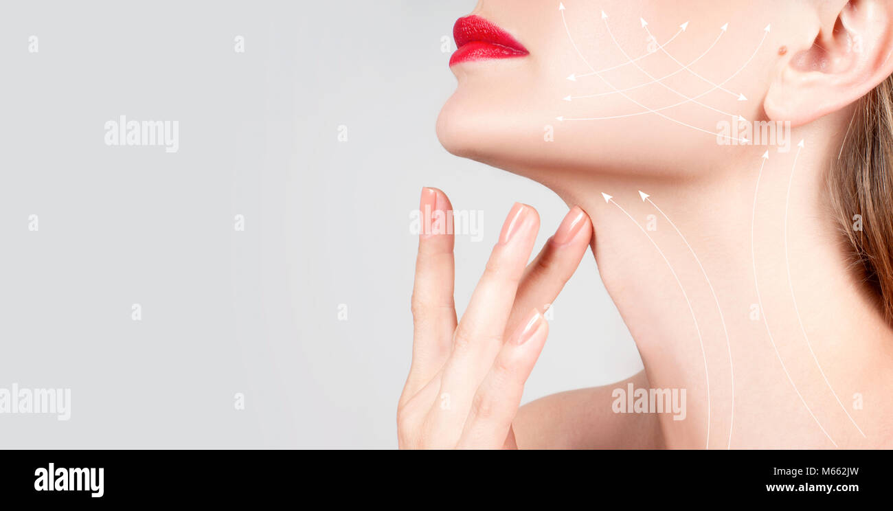 Anti-aging treatment and face lift. Beautiful woman neck with massage lines or lifting arrows Stock Photo