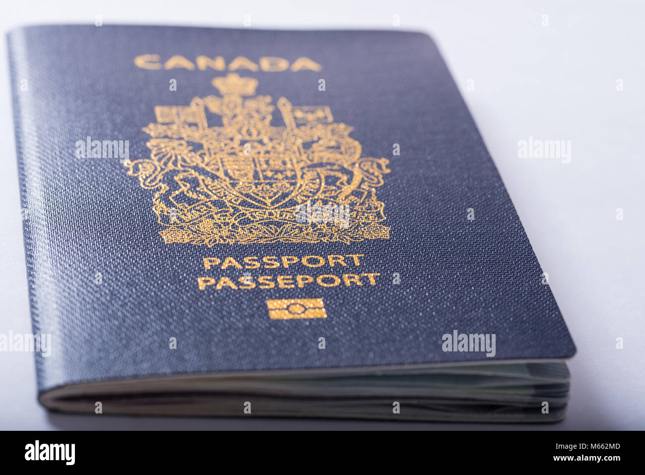 Close up view of a Canadian Passport on white background - Stock Image