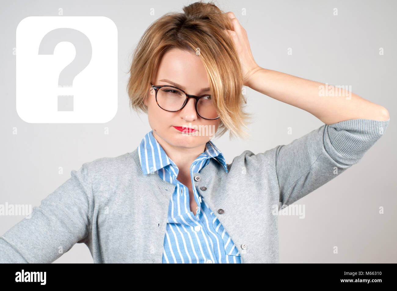 Thinking woman with questioning expression and question mark. Brainstorm. Idea concept - Stock Image