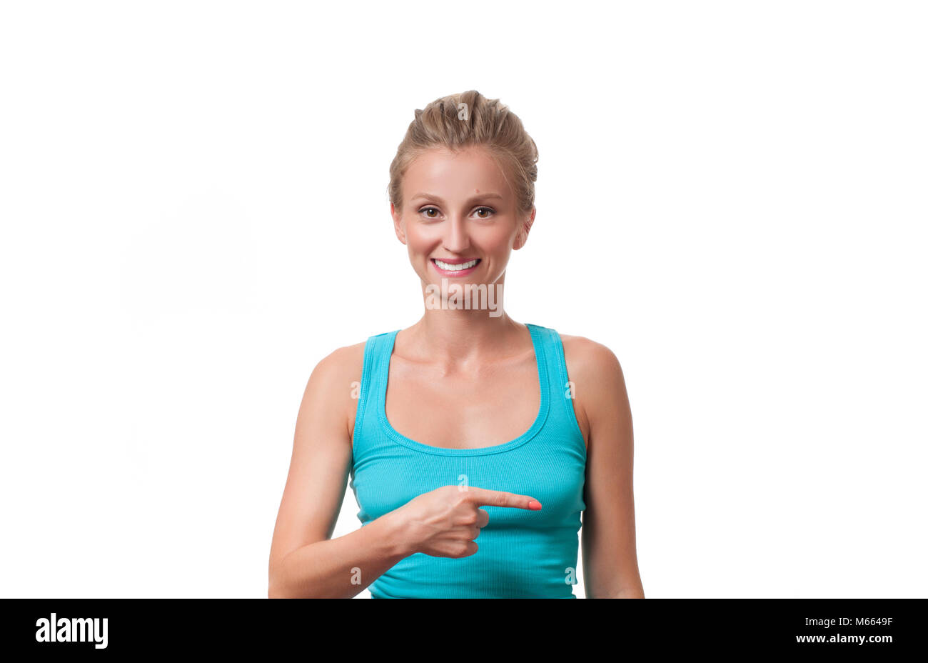 Beautiful business woman pointing something finger at copy space - Stock Image