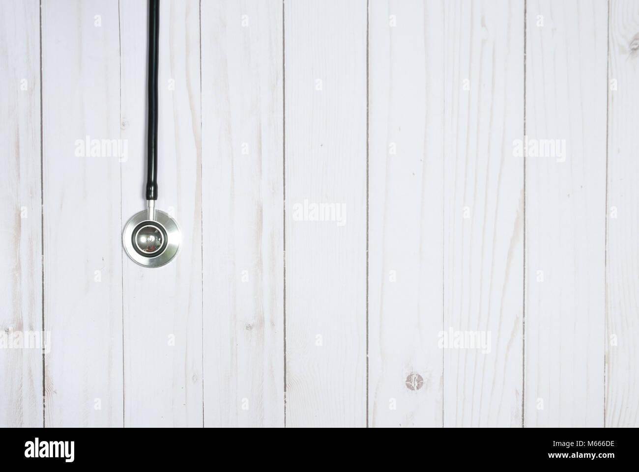 Medical stethoscope on white desk. Medicine concept - Stock Image