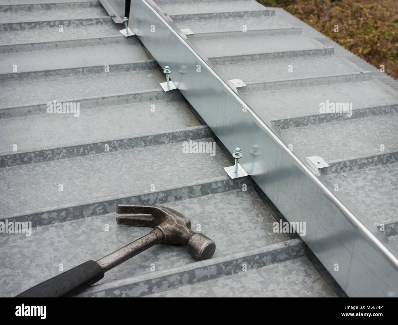 The barrier for snow guard on the edge of a metal roof - Stock Image