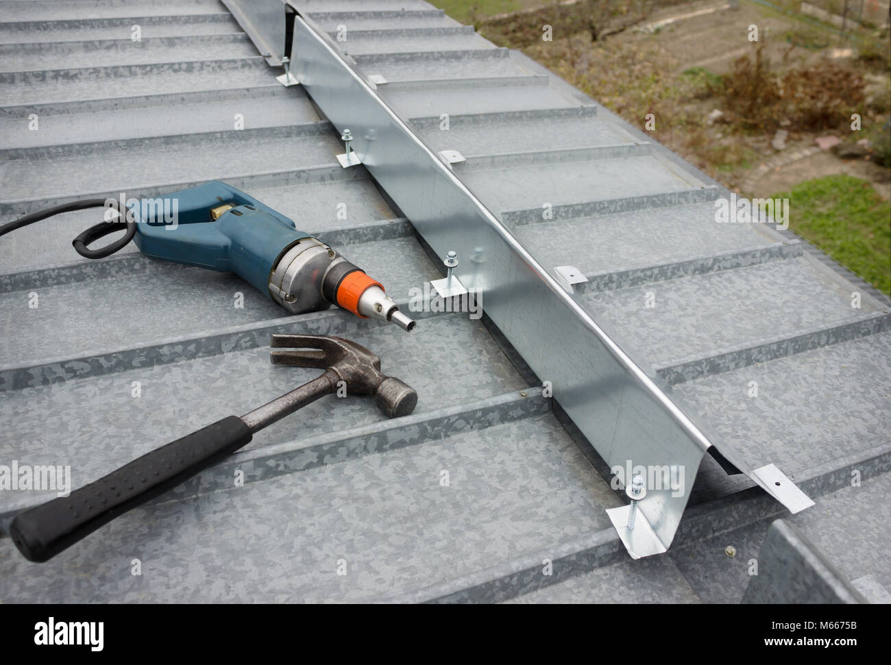 It made a barrier to the snow guard on the edge of a metal roof - Stock Image
